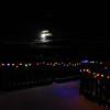 Full moon rising over the Christmas lights