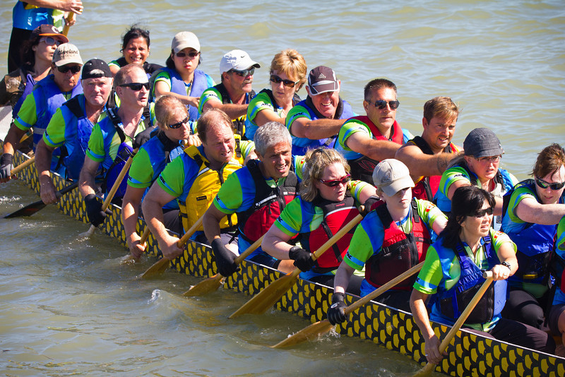 """Race 38 / 500m: Team """"FLCC SOAR"""" paddles to the start line for the Division B Championship race at the 2011 Steveston Dragon Boat Festival."""