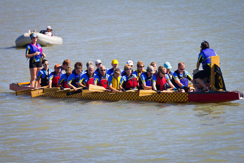 """Race 38 / 500m: Team """"Draggin Riders"""" paddles to the start line for the Division B Championship race at the 2011 Steveston Dragon Boat Festival."""