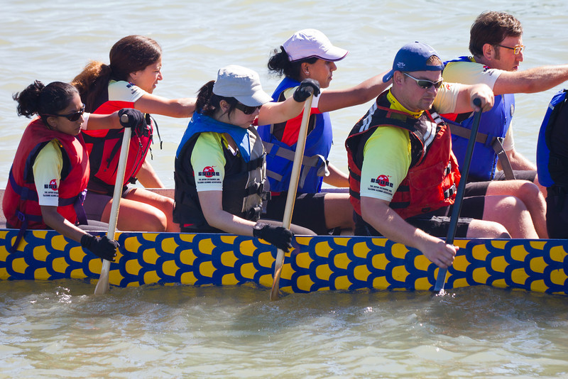 """Race 38 / 500m: Team """"Ready, JET Go"""" paddles to the start line for the Division B Championship race at the 2011 Steveston Dragon Boat Festival."""