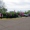 Patriot Guard members standing with flags