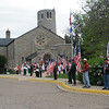 Entrance to chapel, and Patriot Guard members standing with flags