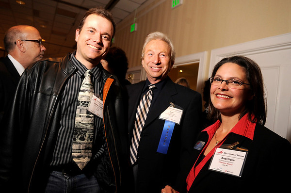 Software engineer David Vollmar, of Gnip, left, Lou Della Cava, owner of LJD Enterprises Inc. and Chamber of Commerce board member Angelique Espinoza pose for a photograph during the Boulder Chamber of Commerce Annual Dinner on Thursday, April 21, at the Millennium Harvest House in Boulder. Della Cava was honored as the Virginia Patterson Business Person of the Year. <br /> Jeremy Papasso/ Camera