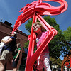 "Elsie Pearson, 2, poses for a photo for her mom with the metal  flamingo made by Fredrick Prescott of Santa Fe.<br /> The Downtown Boulder Fall Festival continues on Sunday on the Pearl Street Mall.<br /> For a video and more photos of the festival, go to  <a href=""http://www.dailycamera.com"">http://www.dailycamera.com</a>.<br /> Cliff Grassmick / September 24, 2011"