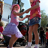 "Kate Kirkegaard, left, and her sister, Taylor, dance to the music of Lois LaFond and the Rockadiles.<br /> The Downtown Boulder Fall Festival continues on Sunday on the Pearl Street Mall.<br /> For a video and more photos of the festival, go to  <a href=""http://www.dailycamera.com"">http://www.dailycamera.com</a>.<br /> Cliff Grassmick / September 24, 2011"