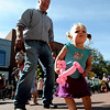 "Robert Clarke, left, and his granddaughter, Sabrina Halsey, 1,  dance to the music of Lois LaFond and the Rockadiles.<br /> The Downtown Boulder Fall Festival continues on Sunday on the Pearl Street Mall.<br /> For a video and more photos of the festival, go to  <a href=""http://www.dailycamera.com"">http://www.dailycamera.com</a>.<br /> Cliff Grassmick / September 24, 2011"