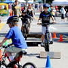 "Evan Heiges, right, takes on the bike course at Boulder Green Streets.<br /> Pearl Street from 15th to Folsom  was closed to traffic for Boulder Green Streets, a play in the street event on Sunday.<br /> For a video and more photos of the event, go to  <a href=""http://www.dailycamera.com"">http://www.dailycamera.com</a>.<br /> Cliff Grassmick / September 18, 2011"