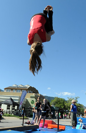 "Jessica Halee of the Boulder Flyers, gets air time during a gymnastics demonstration.<br /> Pearl Street from 15th to Folsom  was closed to traffic for Boulder Green Streets, a play in the street event on Sunday.<br /> For a video and more photos of the event, go to  <a href=""http://www.dailycamera.com"">http://www.dailycamera.com</a>.<br /> Cliff Grassmick / September 18, 2011"