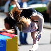"""Madison Hawk of the Boulder Flyers, looks to stick the landing during a gymnastics demonstration.<br /> Pearl Street from 15th to Folsom  was closed to traffic for Boulder Green Streets, a play in the street event on Sunday.<br /> For a video and more photos of the event, go to  <a href=""""http://www.dailycamera.com"""">http://www.dailycamera.com</a>.<br /> Cliff Grassmick / September 18, 2011"""