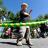 "Hunter Ramsey, 2, gets the hang of the hula hoop at the O Dance booth.<br /> Pearl Street from 15th to Folsom  was closed to traffic for Boulder Green Streets, a play in the street event on Sunday.<br /> For a video and more photos of the event, go to  <a href=""http://www.dailycamera.com"">http://www.dailycamera.com</a>.<br /> Cliff Grassmick / September 18, 2011"