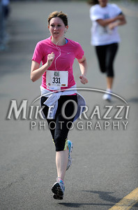 5/7/2011 Mike Orazzi   Staff Kelly Martin of Farmington during the Female 5K run at the CT Breast Health Initiative Race in the Park at Walnut Hill Park in New Britain on Saturday, May 7, 2011.