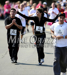 5/7/2011 Mike Orazzi | Staff Greg Tocci of Torrington and Susan Edgerton of Canton during the Female 5K run at the CT Breast Health Initiative Race in the Park at Walnut Hill Park in New Britain on Saturday, May 7, 2011.