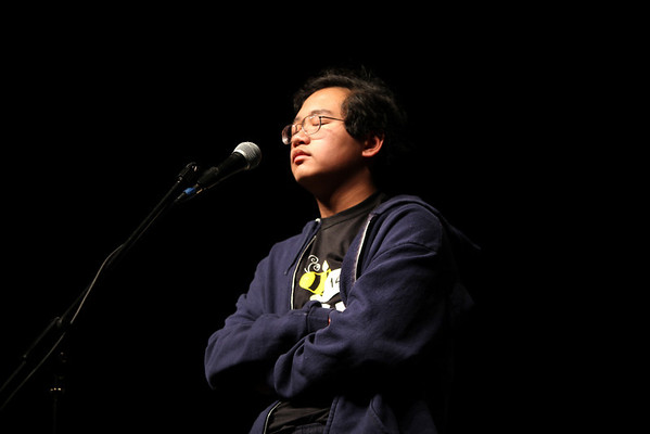 David Phan, 14, from Platt Middle School concentrates on the spelling of the final word  during the final round of the Camera 2011 Regional Spelling Bee held at Monarch High School Saturday Feb. 19, 2011. First place winner lands a trip to compete in the Scripps National Spelling Bee May 29 to June 4, 2011.