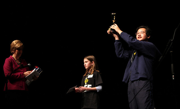 Spelling Bee Coordinator Christine Labozan, left,  hands out prizes to second place winner Bri Cole, middle, and first place winner David Phan, right, during the 2011 Camera Regional Spelling Bee held at Monarch High School Saturday Feb. 19, 2011. Chancey Bush/ The Camera