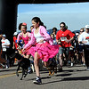 "Isabel Tangel, center, takes off with hundreds of runners and their dogs.<br /> The 11th Annual Canine Classic 5K was held at the Boulder Reservoir on Sunday.<br /> For a  photo gallery and video of the race, go to  <a href=""http://www.dailycamera.com"">http://www.dailycamera.com</a>.<br /> Cliff Grassmick/ April 17, 2011"