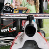 Record-Eagle/Keith King<br /> Michael Capehart, of Fenton, near his cousin's son, Mason Fritzgerald, 2, of Colombus, OH, and his cousin's daughter, Maggie Fritzgerald, 5, plays in an IndyCar racing simulator at the Verizon IZOD IndyCar tent Saturday, July 2, 2011 during the opening day of the National Cherry Festival.