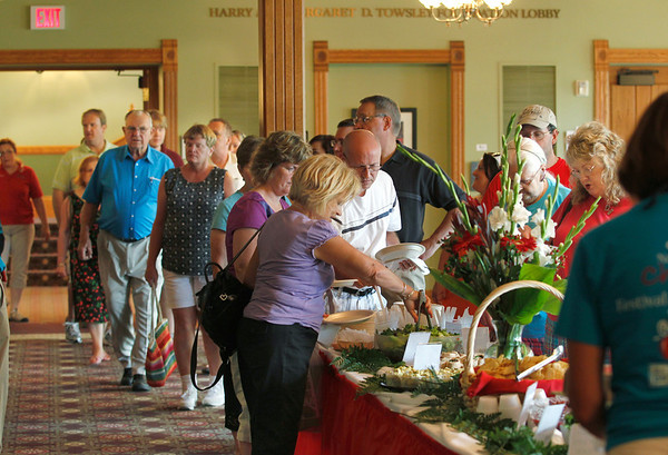 Record-Eagle/Jan-Michael Stump<br /> A crowd lines up for a seating of the Cherries Grand Buffet at the City Opera House. Over 300 people sampled recipes from the Good Eats Cafe, all using cherries.