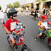 Record-Eagle/Keith King<br /> Isaac Dressel, left, 6, of Virginia, and Will Turnquist, right, 3, of Traverse City, ride their bicycles on Front Street Thursday, July 7, 2011 during the Touchstone Energy Junior Royale Parade.