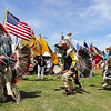Record-Eagle/Keith King<br /> Hank Bailey, left, of Cedar, along with others, dances during a Native American powwow Tuesday, July 5, 2011 at the Open Space during the National Cherry Festival.