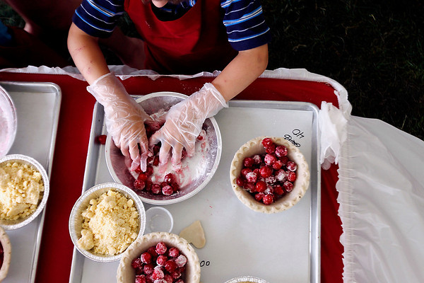 Record-Eagle/Jan-Michael Stump<br /> Mason Cox (cq), 4, of Traverse City makes his own cherry pie at the Grand Traverse Pie Make and Bake Thursday during the National Cherry Festival.