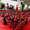 Record-Eagle/Keith King<br /> Cherries from Edmondson Orchards are sold near the Open Space Saturday, July 2, 2011 during the opening day of the National Cherry Festival.