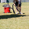 Record-Eagle/Jan-Michael Stump<br /> Matt Haase (cq) vacuums broken glass from the grass at the Open Space following a jaws of life demonstration during Hero's Day Monday at the National Cherry Festival.