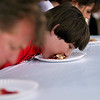 Record-Eagle/Keith King<br /> Lance Woodstra, 13, of San Clemente, CA, competes Friday, July 8, 2011 in the Adult Cherry Pie Eating Contest during the National Cherry Festival.