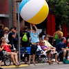 Record-Eagle/Jan-Michael Stump<br /> Vin Soffredine (cq), 6, hits a giant beach ball tossed by a float in the Cherry Royale Parade Saturday.