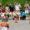 Record-Eagle/Keith King<br /> Cheering takes place at the finish line as participants pedal toward the finish line in the National Cherry Festival Kids' Big Wheel Race Saturday, July 2, 2011 at the Grand Traverse County Civic Center.