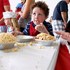 Record-Eagle/Jan-Michael Stump<br /> Mason Cox (cq), 4, of Traverse City samples the crumb topping while making his own cherry pie at the Grand Traverse Pie Make and Bake Thursday during the National Cherry Festival.