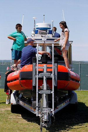 Record-Eagle/Jan-Michael Stump<br /> U.S. Coast Guard Seaman Chris Yaw (cq) gives a tour of the guard's 25-foot R.B.S. (Response Boat Small) to twins Jonathon and Jennifer Deeren (cq), 11, at the Open Space during Hero's Day Monday at the National Cherry Festival.