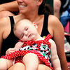 Record-Eagle/Jan-Michael Stump<br /> Elizabeth Hess (cq), 6 months, sleeps in the lap of her grandmother, Nan Lewis (cq) of Interlochen during the Cherry Royale Parade Saturday.