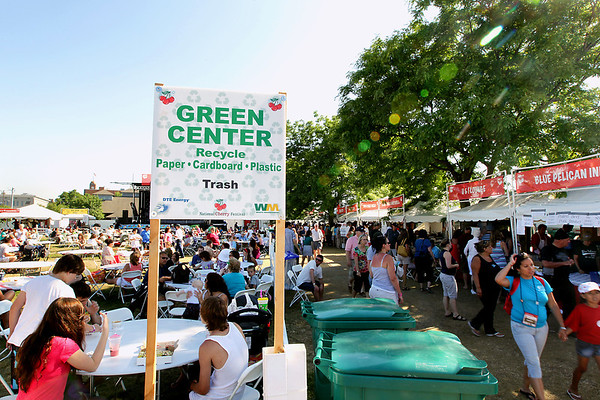 Record-Eagle/Keith King<br /> A 'Green Center' sign is displayed Friday, July 8, 2011 at the Open Space during the National Cherry Festival.