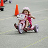 Record-Eagle/Keith King<br /> McAra Sovis, 6, of Traverse City, pedals toward the finish line for a first-place finish in her age division Saturday, July 2, 2011 during the National Cherry Festival Kids' Big Wheel Race at the Grand Traverse County Civic Center. Sovis has also won first place in her division when she was four years old and five years old.
