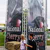 Record-Eagle/Keith King<br /> Mariah Bitely, left, 16, and Katie Skrzypczak, 14, both of Traverse City, walk past National Cherry Festival banners Friday, July 1, 2011 toward the Open Space. Friday's hot, humid weather is not expected to last, said Jeff Halblaub, meteorologist with the National Weather Service in Gaylord. There's a slight chance for wet weather through this afternoon, but once the skies clear, humidity will drop and temperatures will return to normal. Expect highs in the low 80s Sunday and Monday with sunny skies and overnight lows in the upper 50s. For a complete schedule of Saturday's Cherry Festival events, see Page 3A.