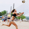 Record-Eagle/Keith King<br /> Katherine Oetjens, of Traverse City, runs down the ball as she competes Saturday, July 2, 2011 in the Two-Person Beach Volleyball Tournament near West End Beach during the opening day of the National Cherry Festival.