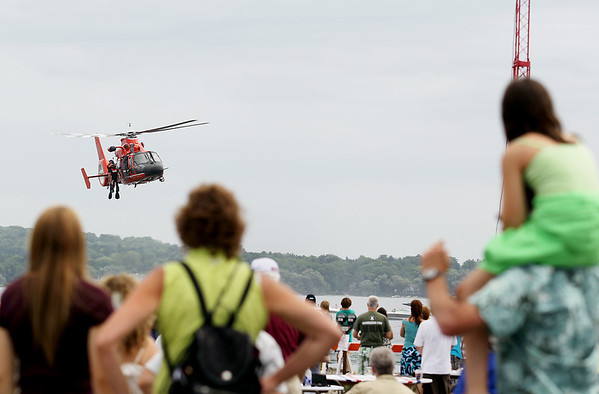 Record-Eagle/Keith King<br /> Members of the United States Coast Guard Airstation Traverse City perform a demonstration over West Grand Traverse Bay Saturday, July 2, 2011 as part of the National Cherry Festival Air Show.