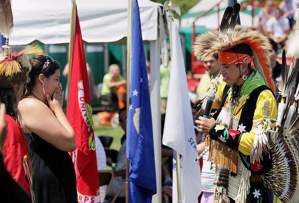 Record-Eagle/Keith King<br /> Kyle Kilbourne, right, of Suttons Bay, talks to his girlfriend Areial Tyler (cq), of Suttons Bay, prior to getting on one knee and proposing to her Tuesday, July 5, 2011 during a Native American powwow at the Open Space during the National Cherry Festival. Tyler accepted Kilbourne's proposal.