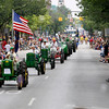 Record-Eagle/Jan-Michael Stump<br /> The Great Lakes Antique Tractor Club makes it's way down Front Street during the Cherry Royale Parade Saturday.