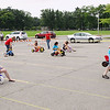 Record-Eagle/Keith King<br /> National Cherry Festival Junior and Intermediate Ambassadors take part in a big wheel race after the Kids' Big Wheel Race had ended Saturday, July 2, 2011 at the Grand Traverse County Civic Center.