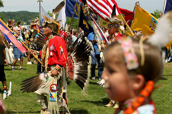 Record-Eagle/Keith King<br /> Head Veteran, Jack Swanson, of Traverse City, dances during a Native American powwow Tuesday, July 5, 2011 at the Open Space during the National Cherry Festival.
