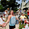 Record-Eagle/Jan-Michael Stump<br /> Isabella Wicksall (cq), 8, gets sprayed with water by Kristen Domine (cq) from the Traverse City St. Francis Gladiator Band during the Cherry Royale Parade Saturday.