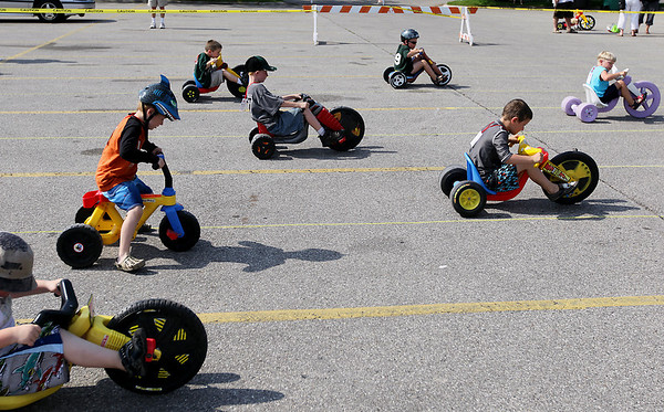 Record-Eagle/Keith King<br /> Kids race Saturday, July 2, 2011 during the National Cherry Festival Kids' Big Wheel Race at the Grand Traverse County Civic Center.