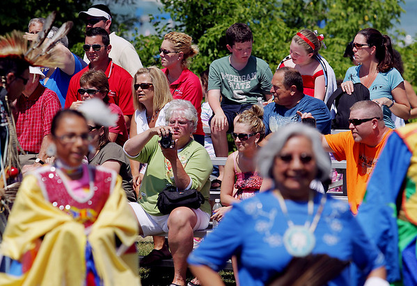 Record-Eagle/Keith King<br /> Spectators watch as a Native American powwow takes place Tuesday, July 5, 2011 at the Open Space during the National Cherry Festival.