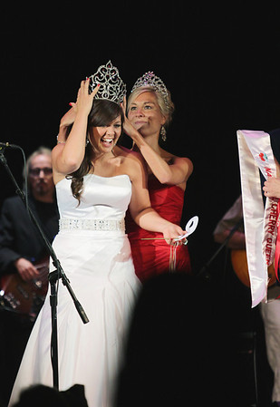Record-Eagle/Keith King<br /> Jordan Blaker, left, has her tiara put in place, after being announced as the 2011-2012 National Cherry Queen, by 2010-2011 National Cherry Queen, Maria LaCross, Friday, July 8, 2011 during the 2011 Cherry Festival Queen's Coronation Ball at the City Opera House.