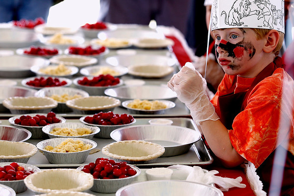 Record-Eagle/Jan-Michael Stump<br /> Levi Proehl (cq), 6, of Traverse City waits to start making his cherry pie at the Grand Traverse Pie Make and Bake Thursday during the National Cherry Festival.