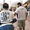 Record-Eagle/Jodee Taylor<br /> Grant Forrester, left, of Traverse City, and Phil Thiel, a friend visiting from Atlanta, walk around the Grand Traverse Mall during training for the 5K in Saturday's Festival of Races, part of the National Cherry Festival.