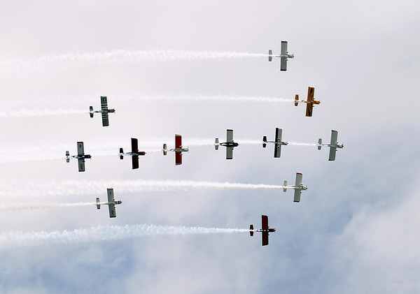 Record-Eagle/Keith King<br /> Team RV performs aerobatics and formations over West Grand Traverse Bay Saturday, July 2, 2011 during the opening day of the National Cherry Festival.