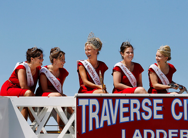Record-Eagle/Jan-Michael Stump<br /> Cherry Queen Maria LaCross (cq), center, laughs with  2011 candidates, from left, Jordan Blaker (cq), Laura Patmore (cq), Evelynne Mende (cq) and Stephanie Neville (cq) during a photo shoot on top of Traverse City Fire Department's Ladder 1 truck during Hero's Day Monday at the National Cherry Festival.