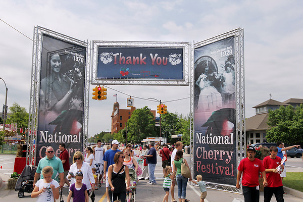 Record-Eagle/Keith King<br /> Festival goers walk toward the National Cherry Festival Saturday, July 2, 2011 during the opening day of the festival.